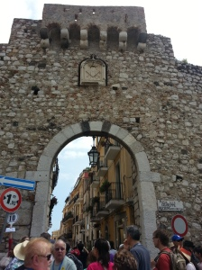 Medieval gate entering city center of Taormina