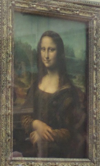 La Giaconda Mona Lisa, Leonardo da Vinci, 1503-1506. This famed painting portrays a woman of contested identiyy whose enigmatic smile has intrigued visitors for years.