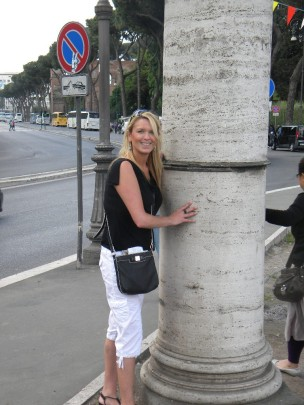 Roaming Historian hugging a column outside the Coliseum