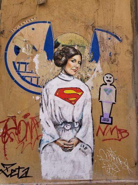 Street art in Florence Italy by artist Lediesis of Princess Leia as Superwoman.